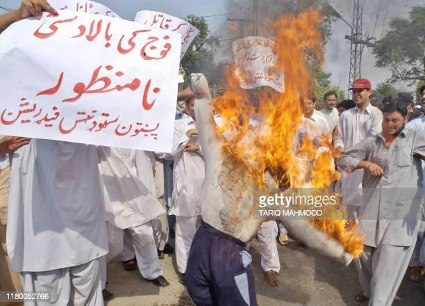 Pakistani protesters burn an effigy of President Pervez Musharraf during a demonstration against the killing of rebel tribal chief Nawab Akbar Bugti...