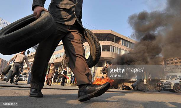 Pakistani protesters burn tyres during a protest against the killing of Shiite Muslims in Lahore on February 6 2009 Pakistani police said they had...