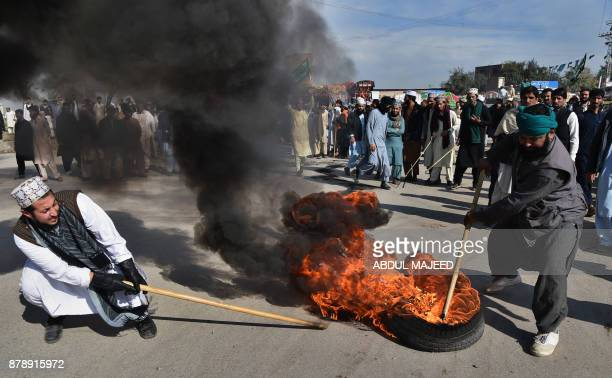Pakistani protesters from the TehreekiLabaik Yah Rasool Allah Pakistan religious burn tyres during a protest in Peshawr on November 25 2017 Pakistani...