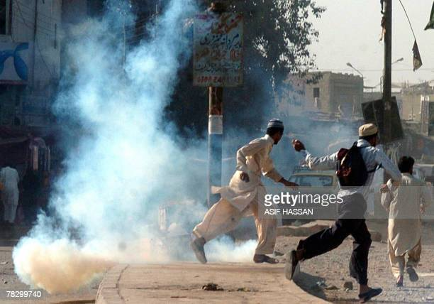 Pakistani protesters of Islami Jamiat Tulba a student wing of fundamentalist party of JamaatiIslami flee as police fire teagas to disperse the mob...