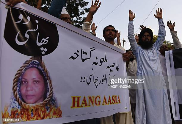 Pakistani protesters shout slogans against Asia Bibi a Christian woman facing death sentence for blasphemy at a protest in Karachi on October 13 2016...