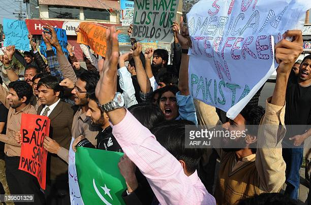 Pakistani protesters shout slogans during a demonstration against the US in Lahore on February 22 2012 Pakistan's Prime Minister Yousuf Raza Gilani...