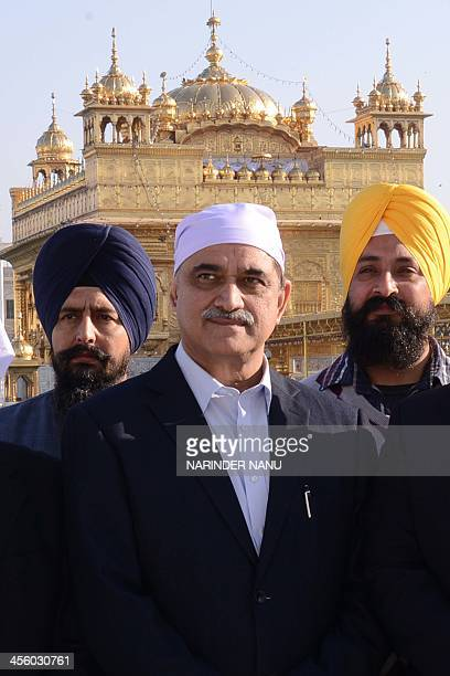 Pakistani Punjab Planning and Development Board Chairman Muhammad Irfan Elahi pays his respects at the Sikh Shrine Golden temple in Amritsar on...