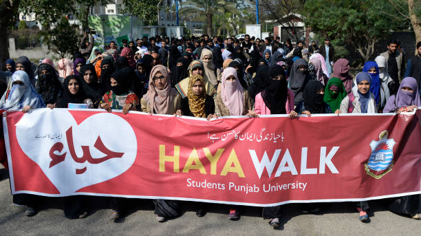 Pakistani Punjab University students carry a banner during a protest against Valentine`s Day in Lahore on February 14 2018 Pakistan`s media regulator.