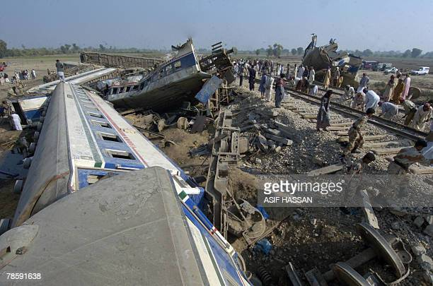 Pakistani railway workers repair the damaged railway track in the southern town of Mehrabpur 20 December 2007 a day after a train accident Pakistan...