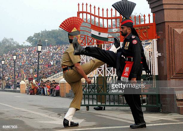 A Pakistani Ranger and an Indian Border Security Force Jawan march during the flaglowering ceremony at the Wagah border on December 1 2008 India's...