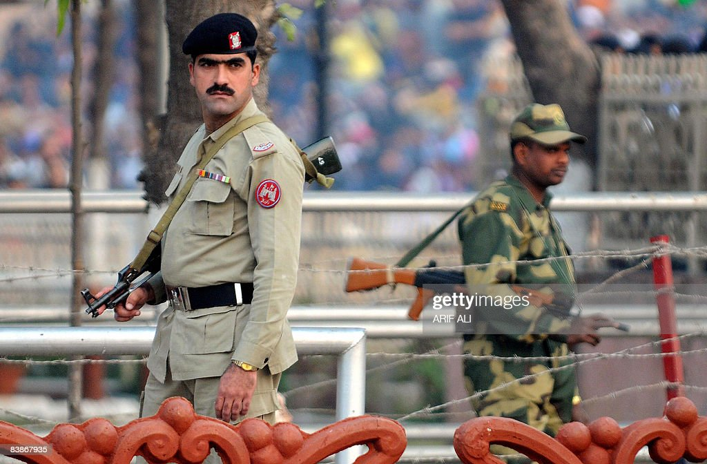 A Pakistani Ranger and an Indian Border Security Force soldier patrol at the Wagah border on December 1 2008 India`s foreign ministry on December 1...
