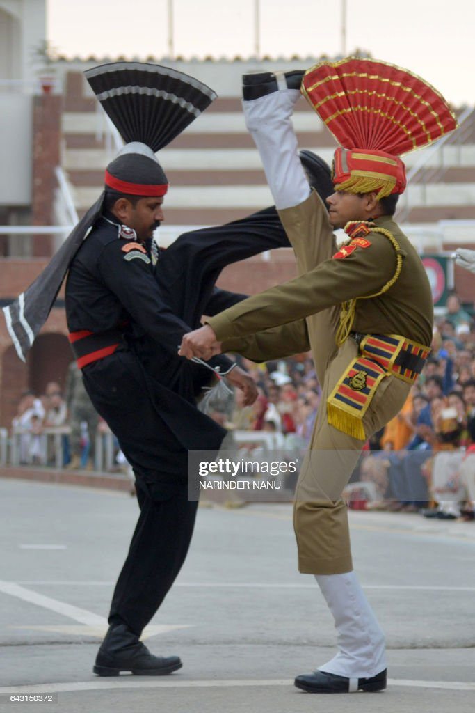 A Pakistani Ranger and an Indian Border Security Force soldier perform during the daily beating of the retreat ceremony aon the IndiaPakistan Border..