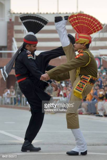 A Pakistani Ranger and an Indian Border Security Force soldier perform during the daily beating of the retreat ceremony aon the IndiaPakistan Border...