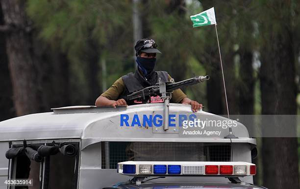 Pakistani Ranger or paramilitary soldier stands on a vehicle as he patrols in the streets on the wake of protests in Islamabad Pakistan on August 15...