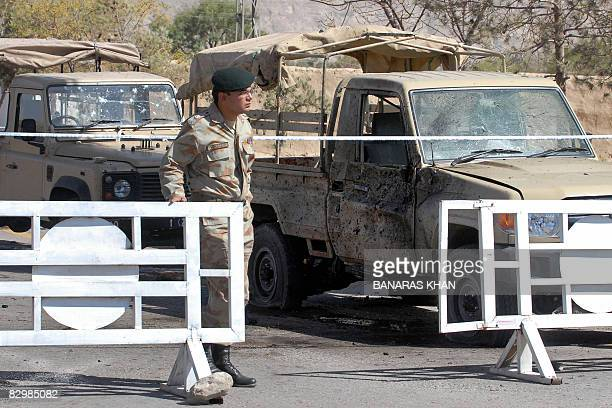 A Pakistani Ranger stands guard at the site of a suicide bomb attack in Quetta on September 24 2008 A suicide bomber blew himself up near a security...