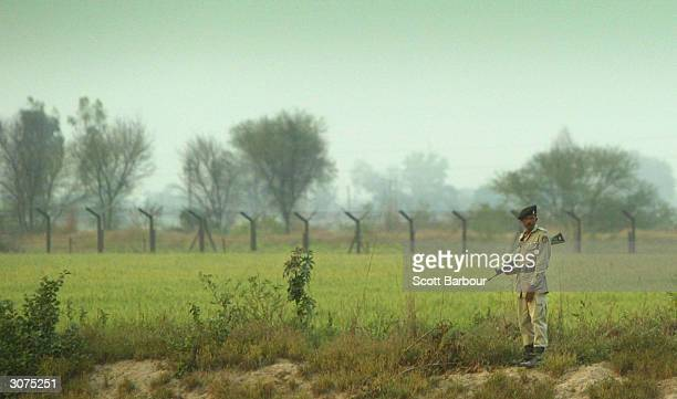 Pakistani Ranger stands guard by the border before the ceremony to lower the national flags at the border crossing between Pakistan and India March...