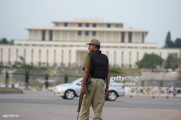 A Pakistani Ranger stands guard in front of the Presidency in Islamabad on June 16 2014 The Pakistani Taliban on June 16 warned foreign firms to...