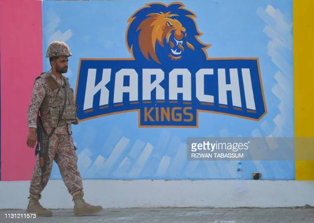 A Pakistani ranger stands guard outside the National Cricket Stadium before the start of the first match of the last eight matches of its domestic...