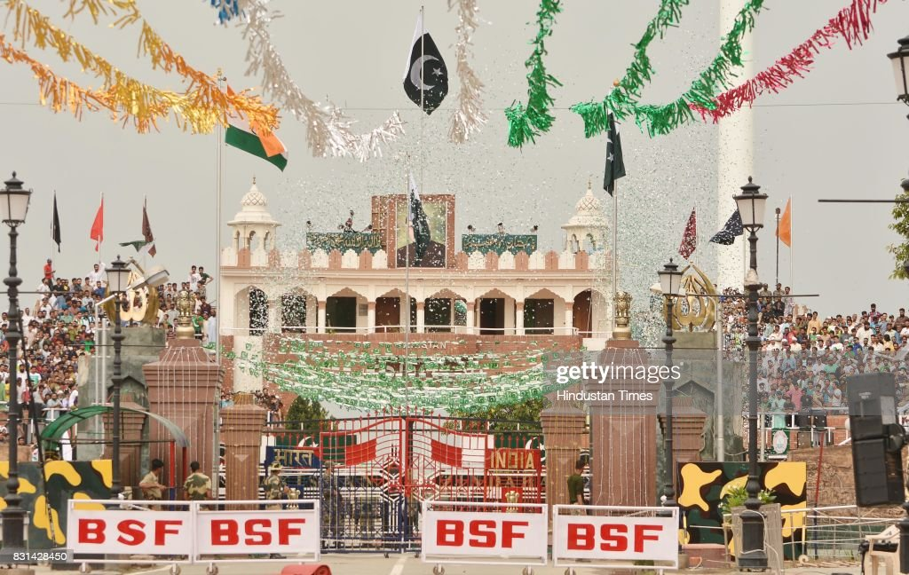 Pakistani Ranger unfurls the Pakistani national flag during a ceremony to celebrate Pakistan`s Independence Day at the IndiaPakistan Wagah Border...