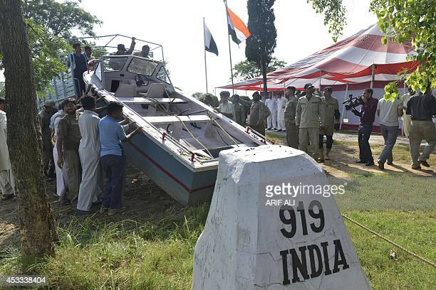 Pakistani ranger upload the boat of Indian border guard Satyasheel Yadav onto a truck at the border post Anayat Hussain Shaheed near Sialkot city 112...