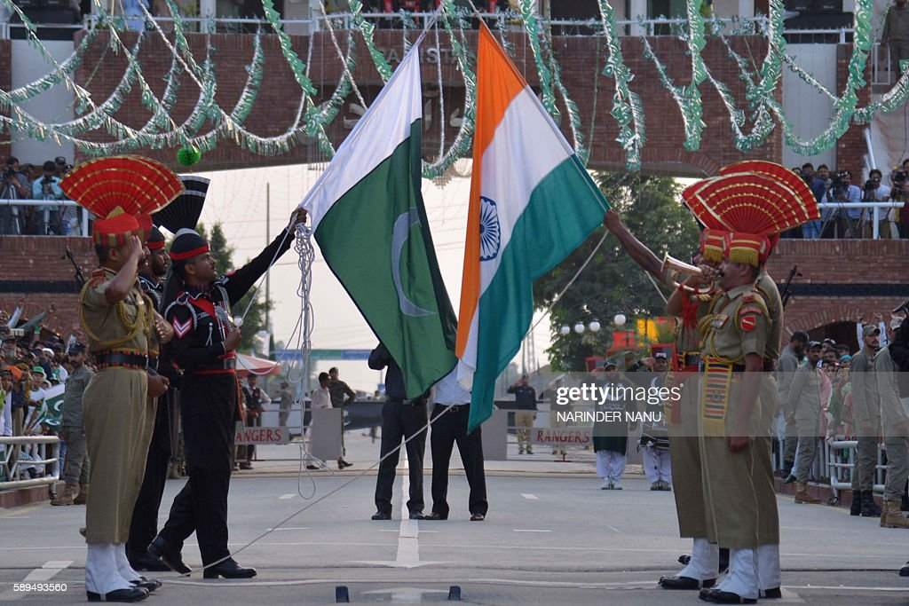 Pakistani Rangers and Indian Border Security Force personnel perform the flag off ceremony at the India Pakistan Wagah Border Post about 35 Km from...