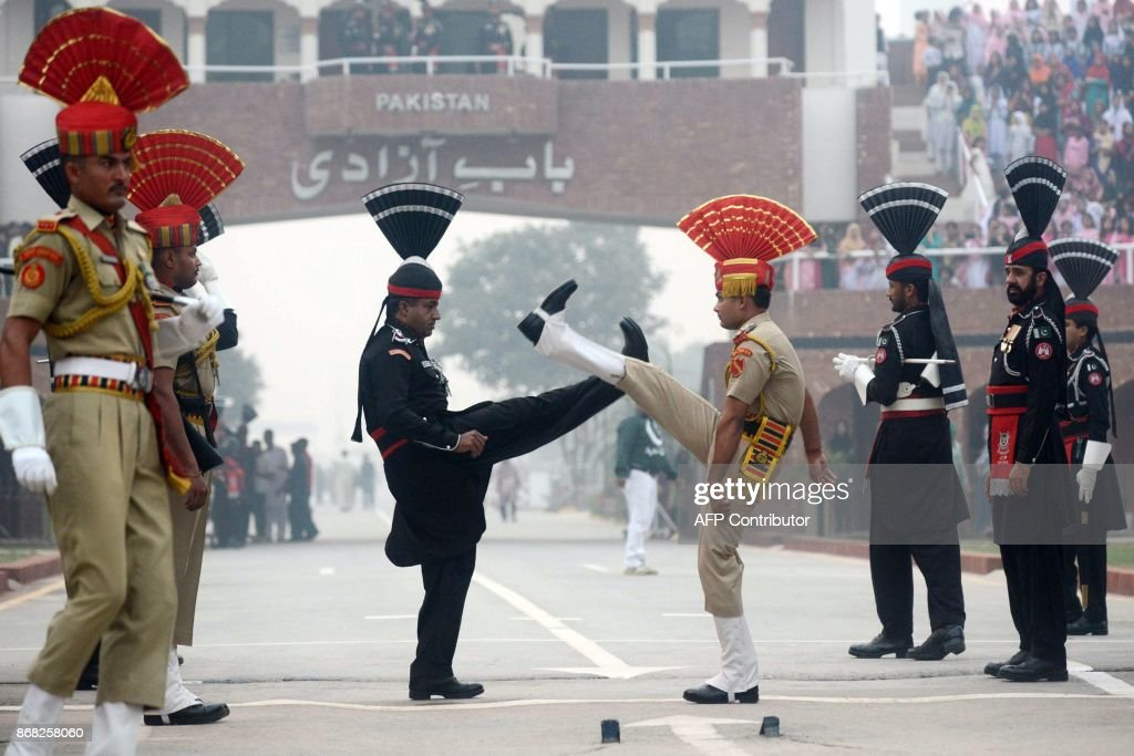 Pakistani Rangers and Indian Border Security Force personnel perform during the daily beating of the retreat ceremony at the IndiaPakistan Wagah...