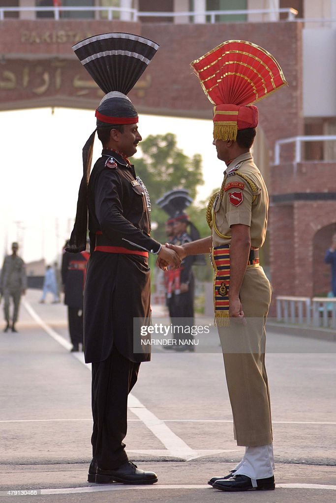 Pakistani Rangers and Indian Border Security Force personnel shake hands during the daily beating of the retreat ceremony at the IndiaPakistan Wagah..