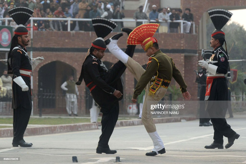 Pakistani Rangers and Indian Border Security Force personnel take part in the daily beating of the retreat ceremony at the IndiaPakistan Wagah Border.