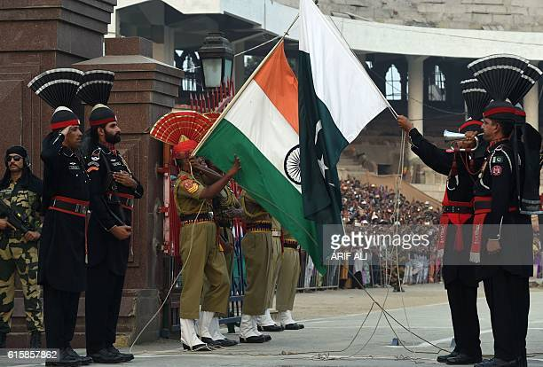 Pakistani Rangers and Indian Border Security Force servicemen perform a flag off ceremony at the IndoPakistani border post of Wagah on October 20...
