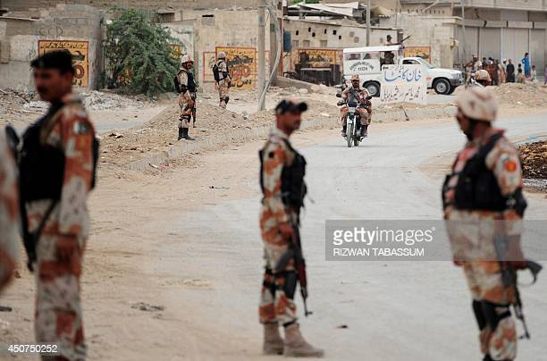 Pakistani Rangers cordon off an area during a search operation in Karachi on June 17 2014 The Pakistani Taliban warned foreign firms to leave the...