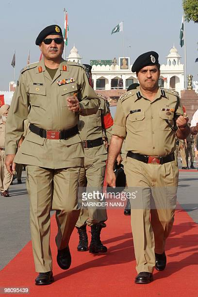 Pakistani Rangers Director-General Major General Muhammad Yaqub Khan is escorted during his arrival by Indian Border Security Force Deputy Inspector...