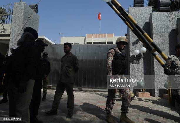 Pakistani rangers gather in front of the gate of the Chinese consulate after an attack in Karachi on November 23 2018 At least two policemen were...