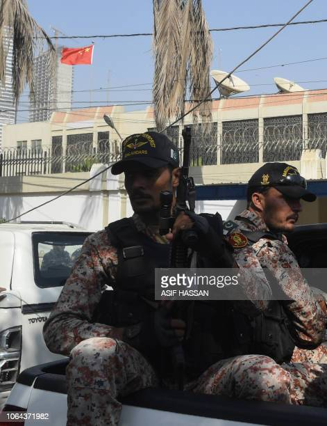 Pakistani rangers look on at the Chinese consulate after an attack in Karachi on November 23 2018 At least two policemen were killed when...