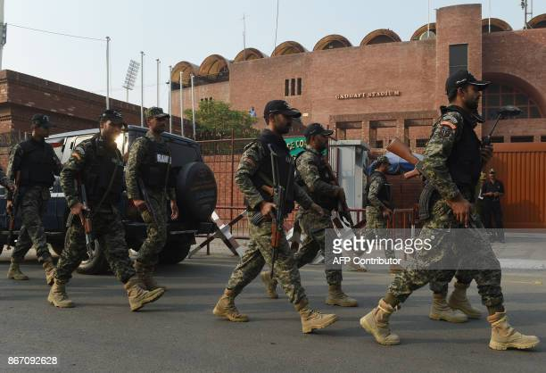 Pakistani Rangers march outside the Gaddafi Cricket Stadium in Lahore on October 27 2017 Tens of thousands of security will be deployed in Lahore on...