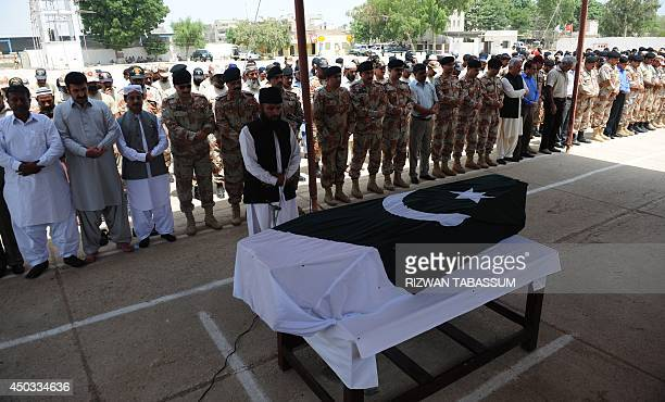 Pakistani Rangers offer funeral prayers for a relative killed in an assault by militants at Karachi's Jinnah International Airport in Karachi on June...