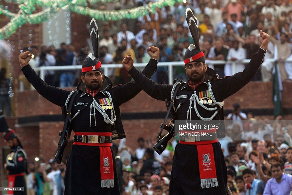Pakistani Rangers perform a flaglowering ceremony at the IndiaPakistan Wagah Border Post near Amritsar on August 14 2016 India celebrates its 70th...