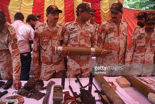 Pakistani Rangers Soldiers display rockets and other weapons recovered during a raid in a presser at Rangers Headquarters Karachi MAY 26 2015 Majid...