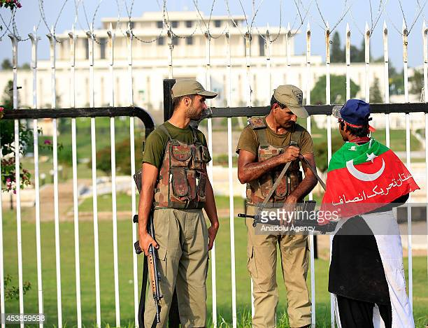 Pakistani rangers stand guard in front of the presidential palace during the ongoing antigovernment protests in Islamabad Pakistan on August 20 2014