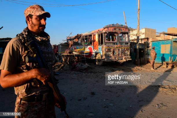 Pakistani rangers stand guard near the site of a bomb blast in Karachi on October 20, 2020. - No casualties have been reported according to local...