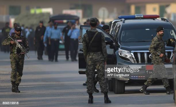 Pakistani rangers stand guard on a street ahead of the arrival of sacked Pakistani prime minister Nawaz Sharif to appear before an accountability...