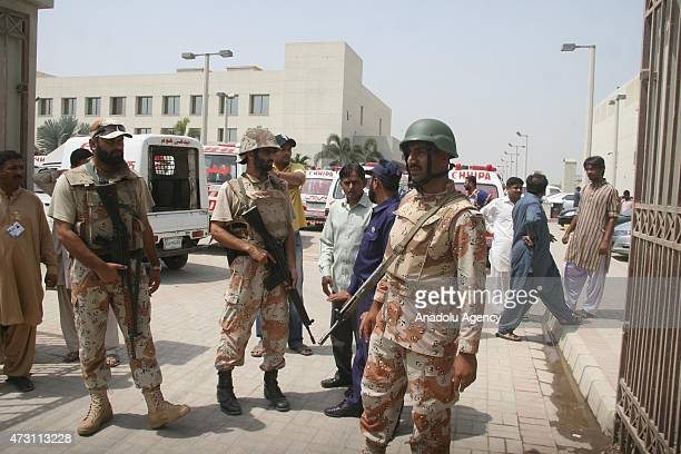 Pakistani rangers stand guard outside a hospital following a gun attack on a bus carrying members of Ismaili Shia community outside a a local...