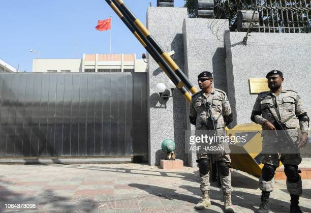 TOPSHOT Pakistani rangers stand in front of the Chinese consulate after an attack in Karachi on November 23 2018 At least two policemen were killed...