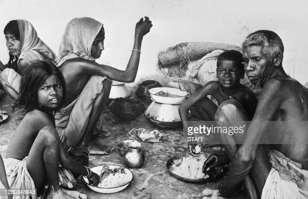 Pakistani refugee family shares their meal on May 27, 1971. Several million refugees have crossed the border from East Pakistan to seek refuge in...