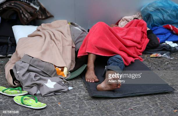 Pakistani refugee Zahib Butt sleeps outside the LaGeSo State Office for Health and Social Services the office for registering migrants on September...