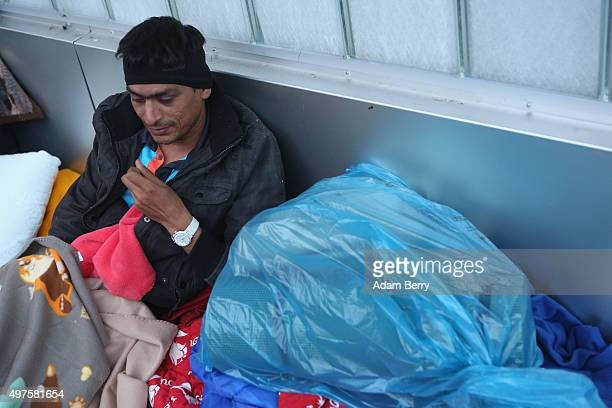 Pakistani refugee Zahib Butt waits outside the LaGeSo State Office for Health and Social Services the office for registering migrants on September 26...