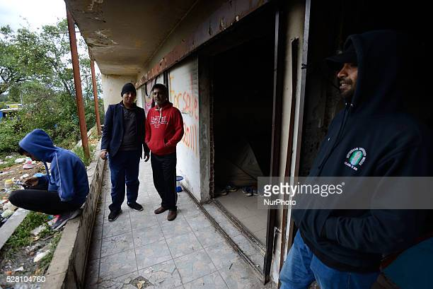 Pakistani refugees in an abandoned building at Hotel Hara makeshift refugee camp in the village of Evzoni seven kilometres south of the Greek...