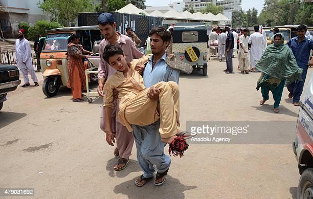 Pakistani relative carries a heatstroke victim to a hospital in Karachi Pakistan June 30 2015 A Pakistani official says the devastating weeklong...