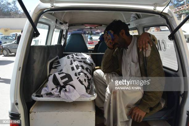 A Pakistani relative mourns beside the body of a polio worker in a ambulance outside a hospital following an attack by gunmen in Quetta on January 18...