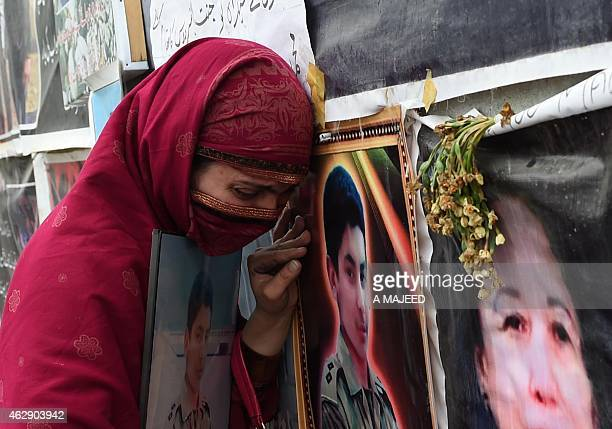 A Pakistani relative of a schoolchild killed in a Taliban attack on the Army Public School reacts during a protest against delays in the...