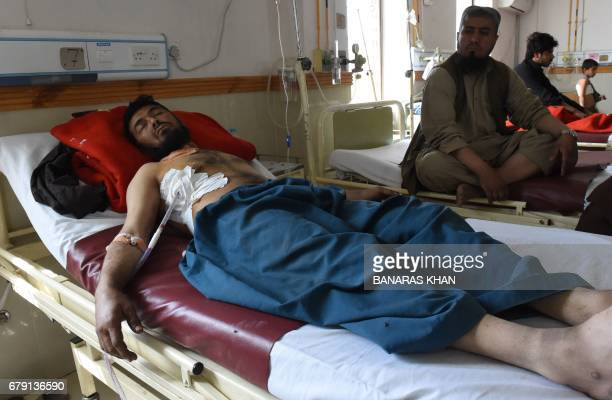 A Pakistani relative sits next to an injured victim of cross border firing at a hospital in Quetta on May 5 2017 Pakistani and Afghan officials have...