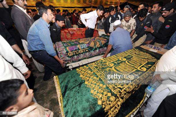 Pakistani relatives and police officials prepare funeral prayers for the victims of a deadly ambush on the Sri Lankan cricket team in Lahore on March...