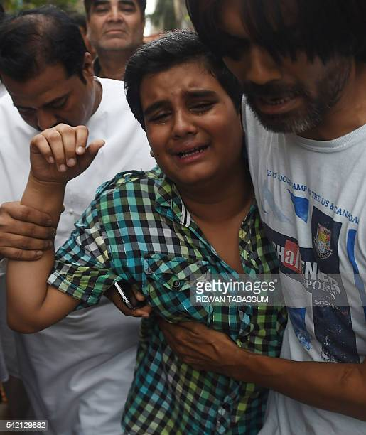 Pakistani relatives comfort Mujjudid Sabri the son of Pakistani Sufi musician Amjad Sabri who was killed in an attack by unknown gunmen in Karachi on...
