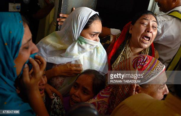 Pakistani relatives mourn after body of the convicted activist Saulat Ali Khan also known as Saulat Mirza arrives following his execution in Karachi...