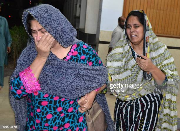 Pakistani relatives mourn after the killing of lawyer Rashid Rehman at a hospital following an attack by gunmen in Multan late May 7 2014 Lawyers in...